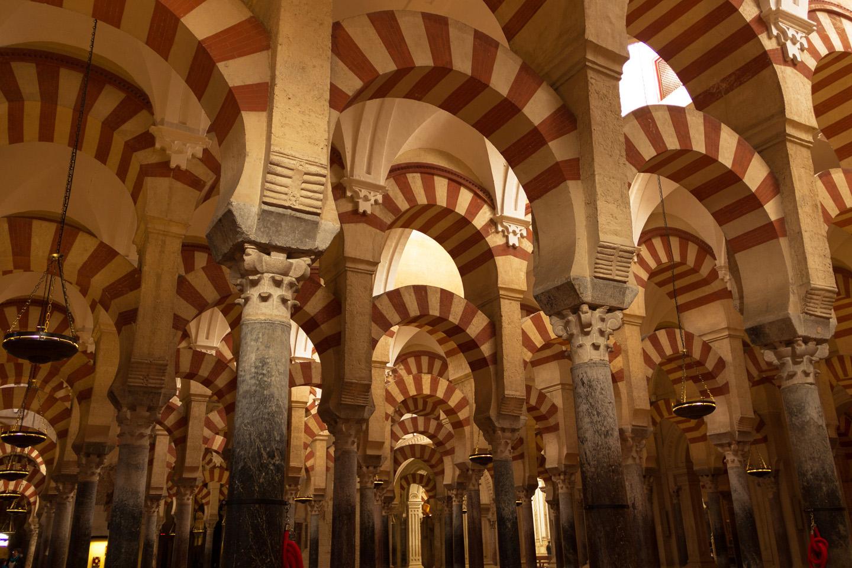 Se empezó a construir como mezquita en el año 785, con la apropiación y reutilización de los materiales de la basílica hispano-romana de San Vicente Mártir, que se hallaba en su lugar, por los conquistadores musulmanes. Tras la reconquista cristiana de Córdoba en 1236, Fernando III de Castilla convirtió la mezquita en catedral.