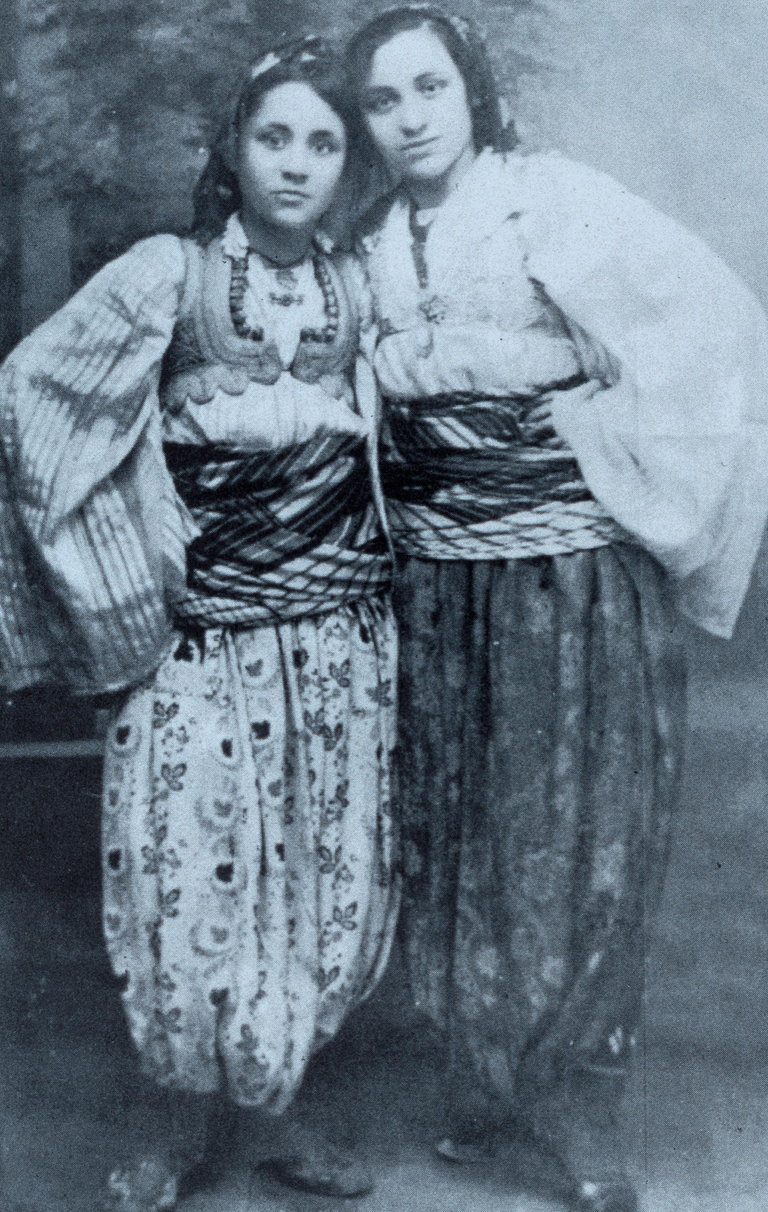 The young Albanian born Anjez�� Gonxhe Bojaxhiu, future Mother Teresa of Calcutta, with her sister Aga, in Macedonian traditional costume. (Photo by Vittoriano Rastelli/Corbis via Getty Images)