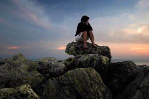 web-woman-stones-rocks-contemplation-bob-jagendorf-cc