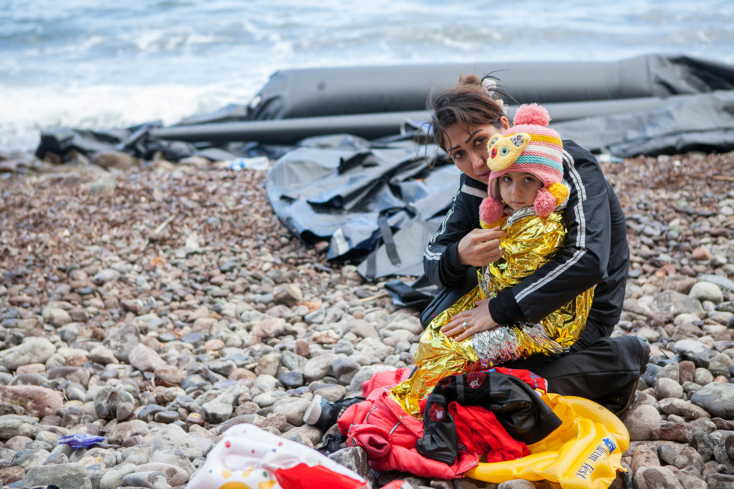 web-refugee-boy-mother-boat-sea-cafod-photo-library-cc
