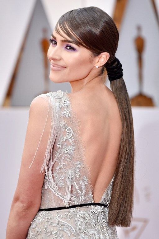 HOLLYWOOD, CA - FEBRUARY 26: Actor Olivia Culpo unveils a one-of-a-kind Marchesa for Stella Artois gown featuring beads made from the Stella Artois Limited-Edition Chalices that benefit Water.org during the 89th Annual Academy Awards at Hollywood & Highland Center on February 26, 2017 in Hollywood, California.   Frazer Harrison/Getty Images/AFP