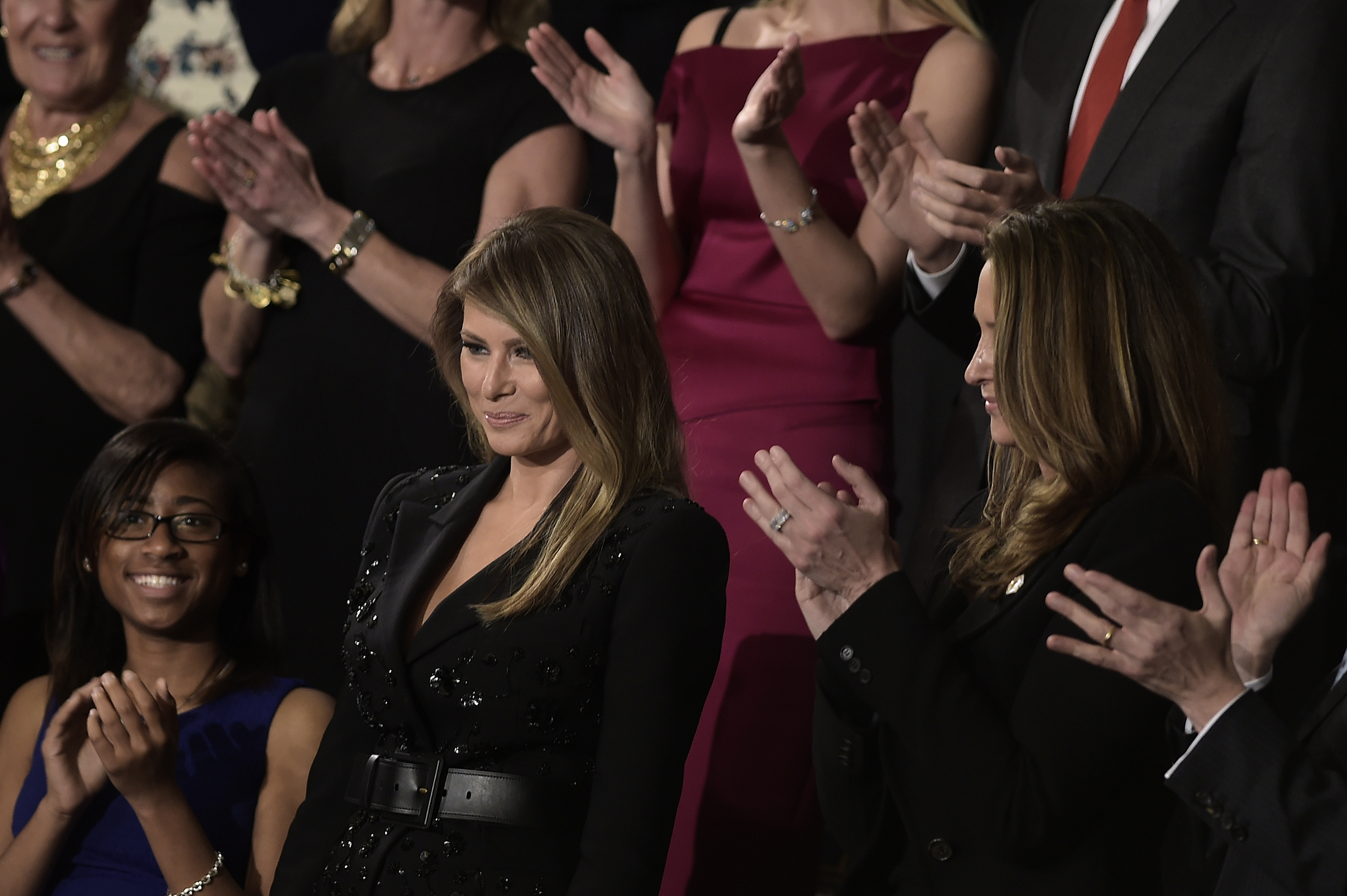 People applaud for US first lady Melania Trump during a joint session of Congress on Capitol Hill February 28, 2017 in Washington, DC. / AFP PHOTO / Brendan Smialowski
