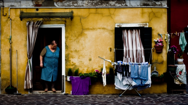 """Venice: Woman at her daily routine. As Jesus said in the Speech on the mountain (Mt 5:1-12): """"Blessed are the poor in spirit, for theirs is the kingdom of heaven. Blessed are the meek, for they will inherit the earth..."""" Photo by Hernan Pinera."""