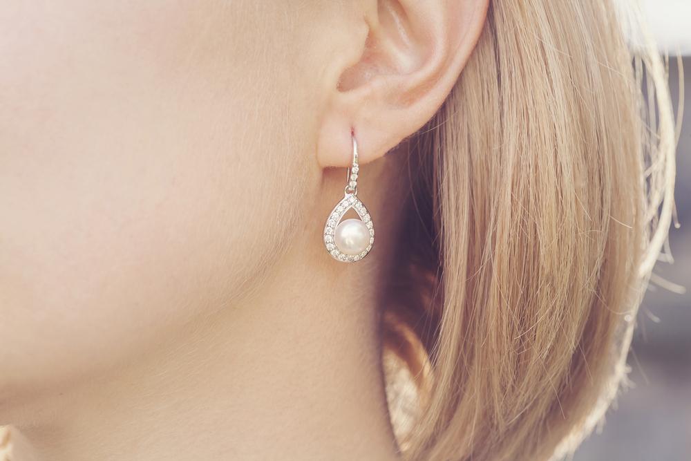 Detail of young woman wearing beautiful luxury earring