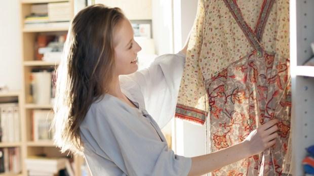 Woman Choosing Clothing