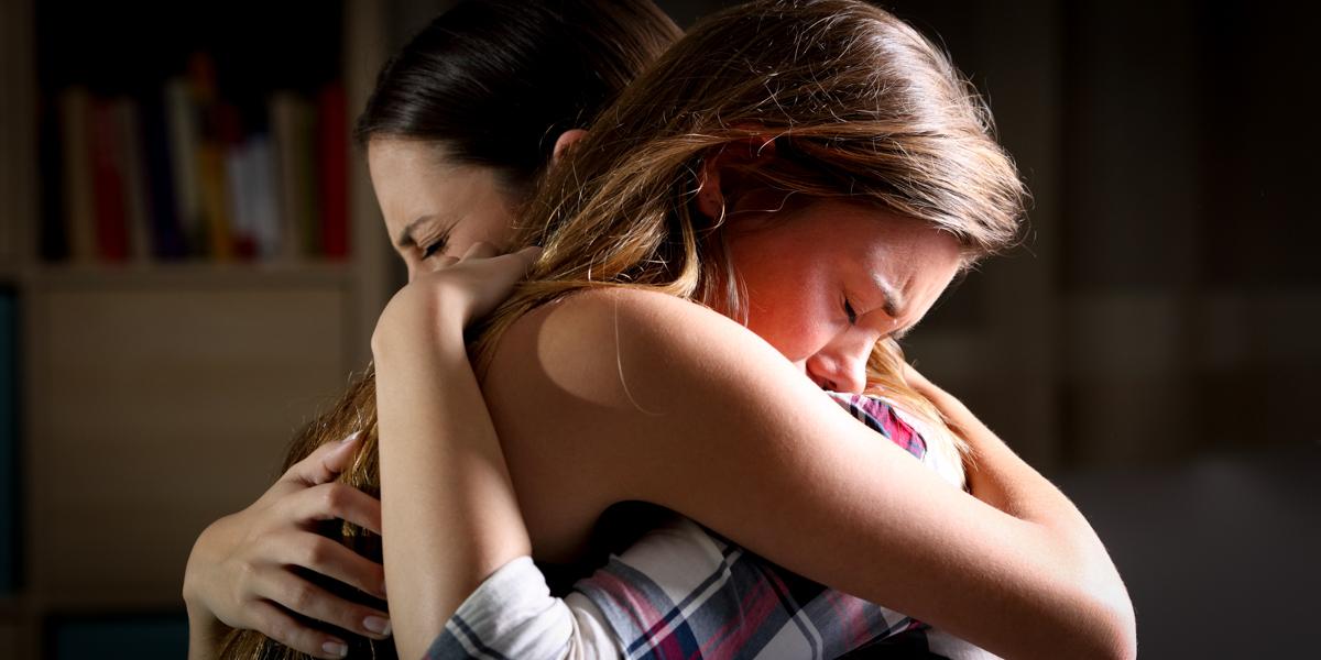 2 WOMAN HUGGING