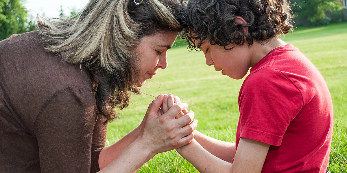 Mother and Son Praying