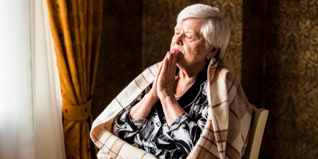 OLDER WOMAN PRAYING