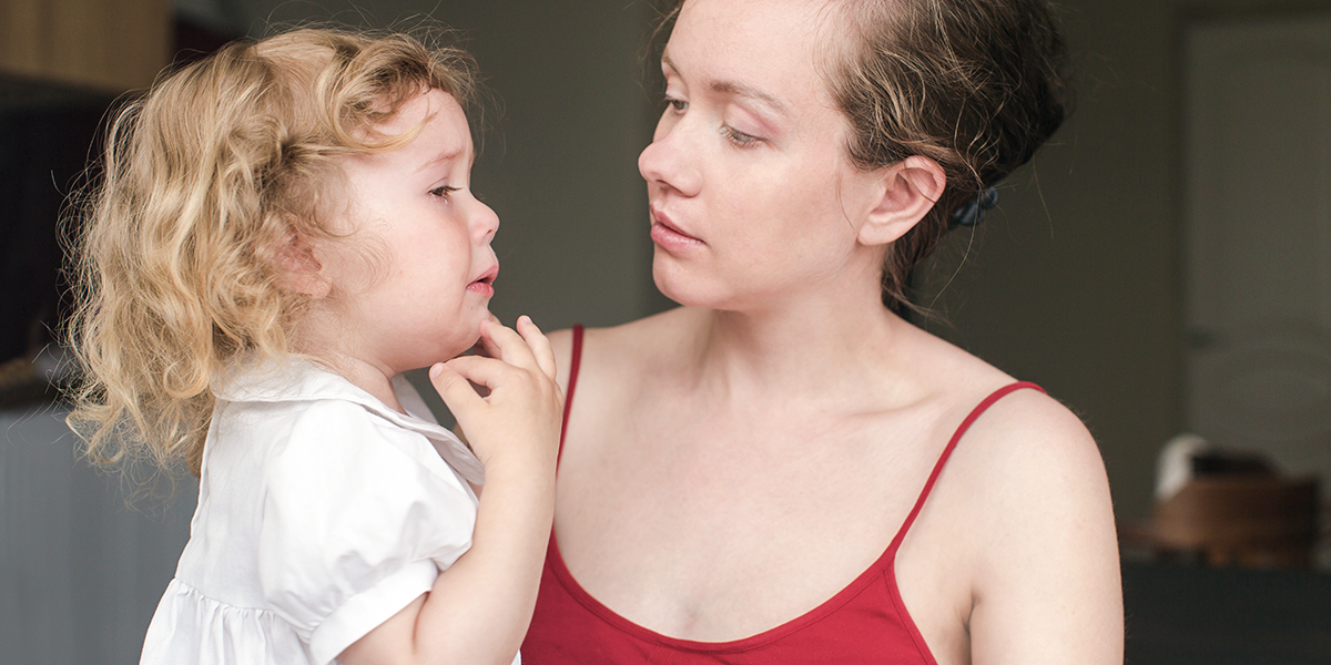 Upset Child with Mother