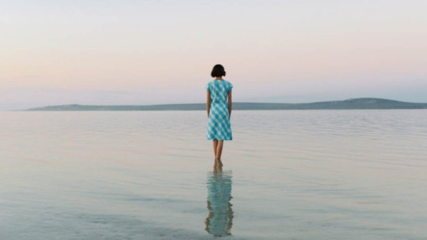 WOMAN STANDING ALONE