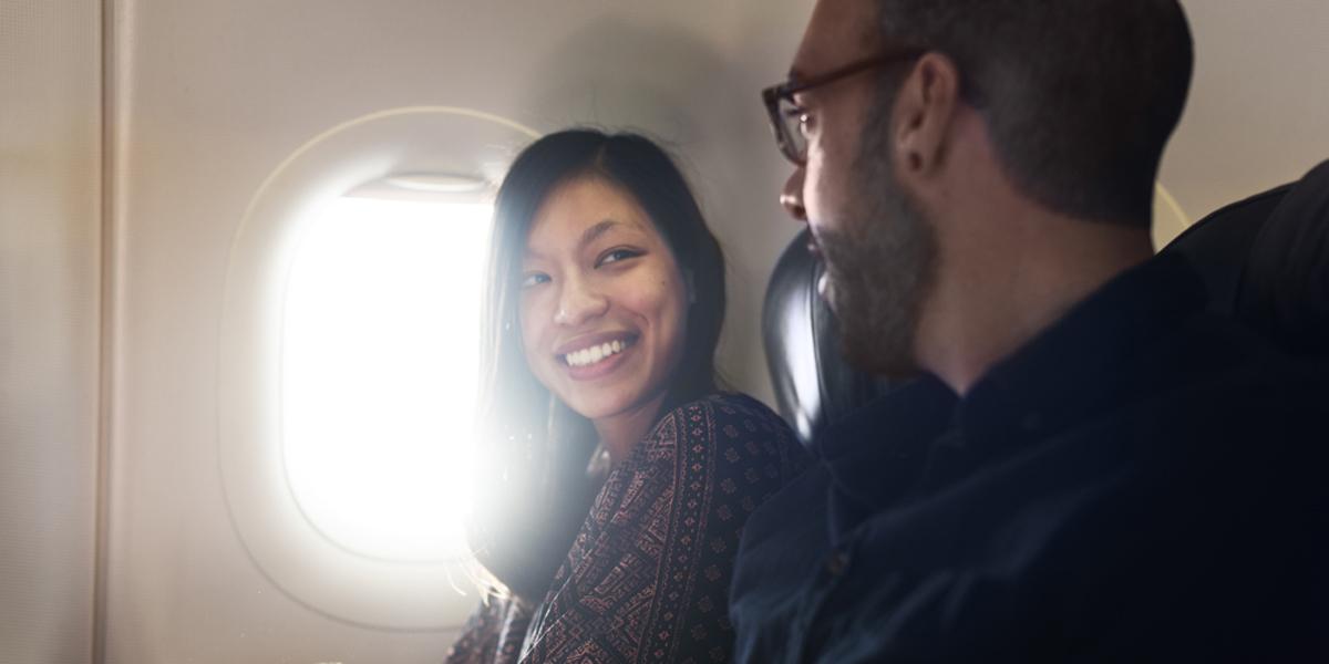 MAN,WOMAN,CONVERSATION,AIRPLANE