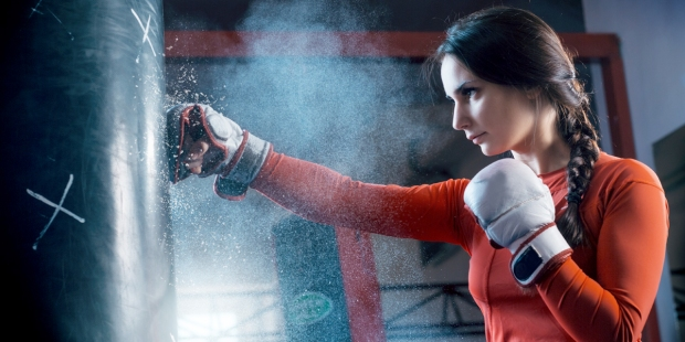 WOMAN,BOXING,PUNCHING BAG