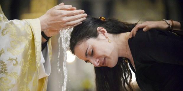 WOMAN BAPTISM