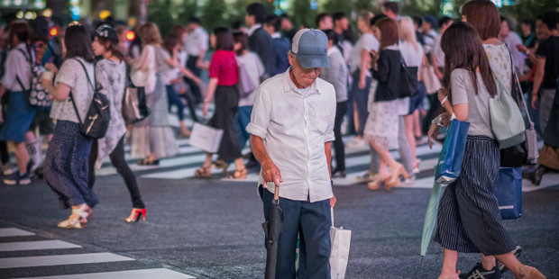 MAN CROSSING THE SHIBUYA SCRAMBLE