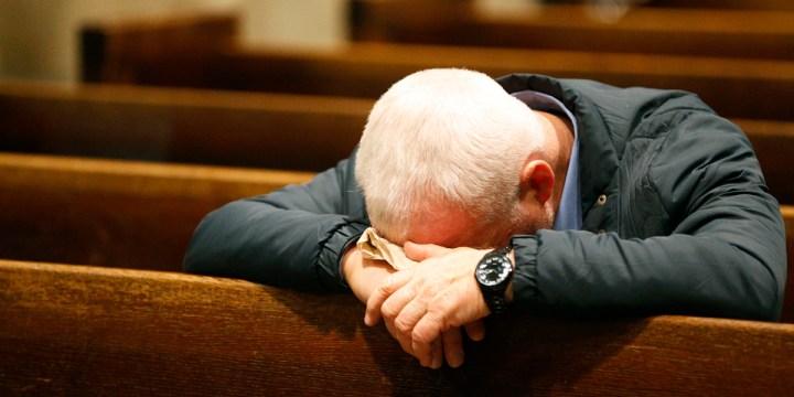 MAN,PRAYS,CHURCH