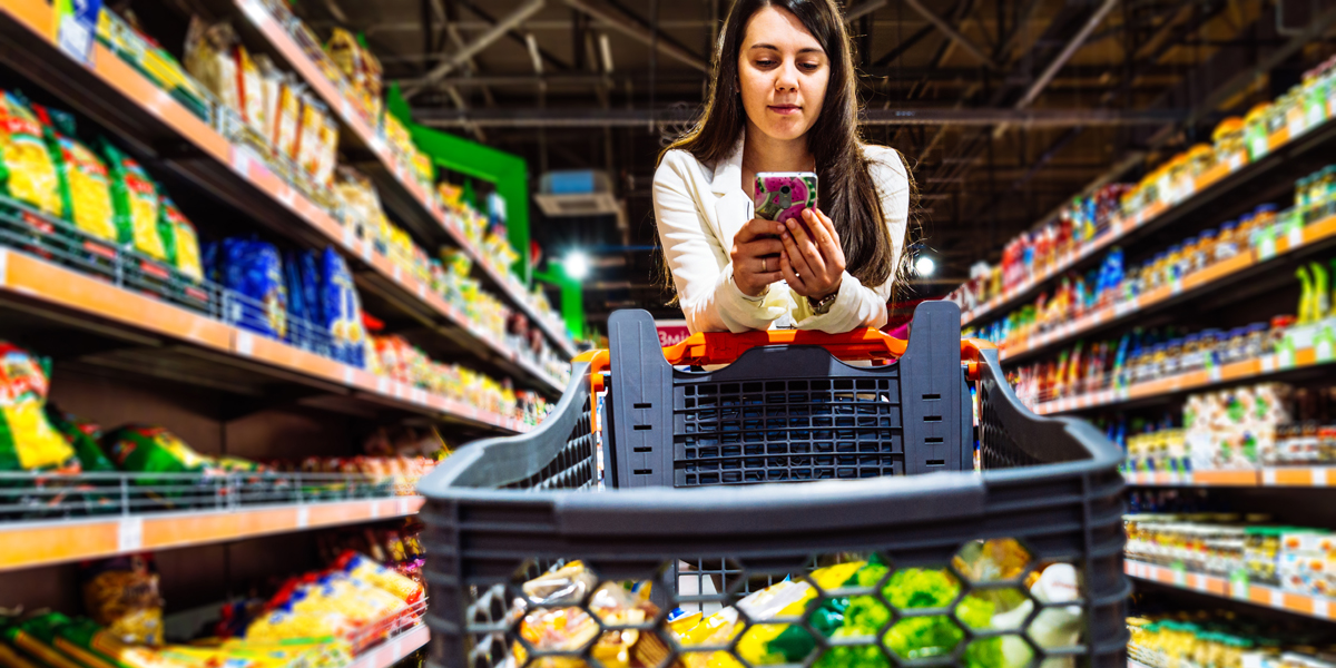 WOMAN,TEXTING,GROCERY STORE