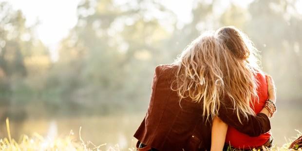 TWO WOMAN HUG