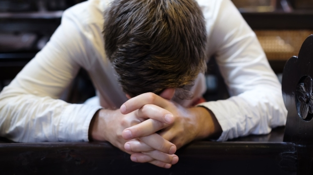 MAN,PRAYING,CHURCH