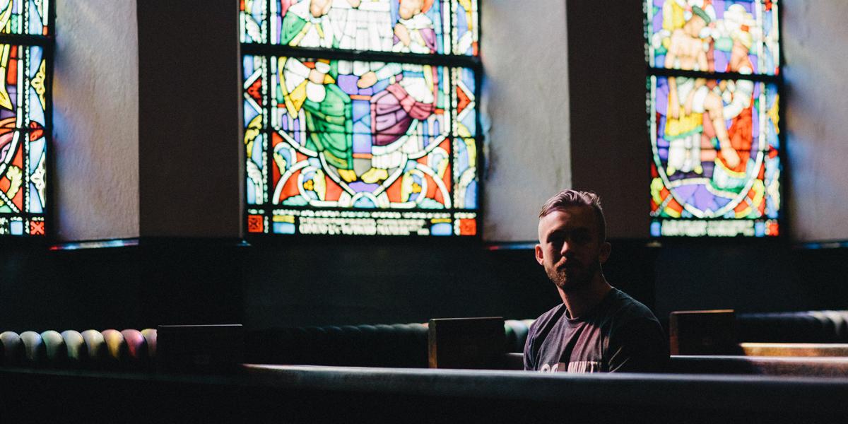 YOUNG,MAN,PRAYING,CHURCH