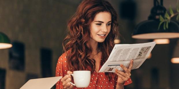 WOMAN,NEWSPAPER