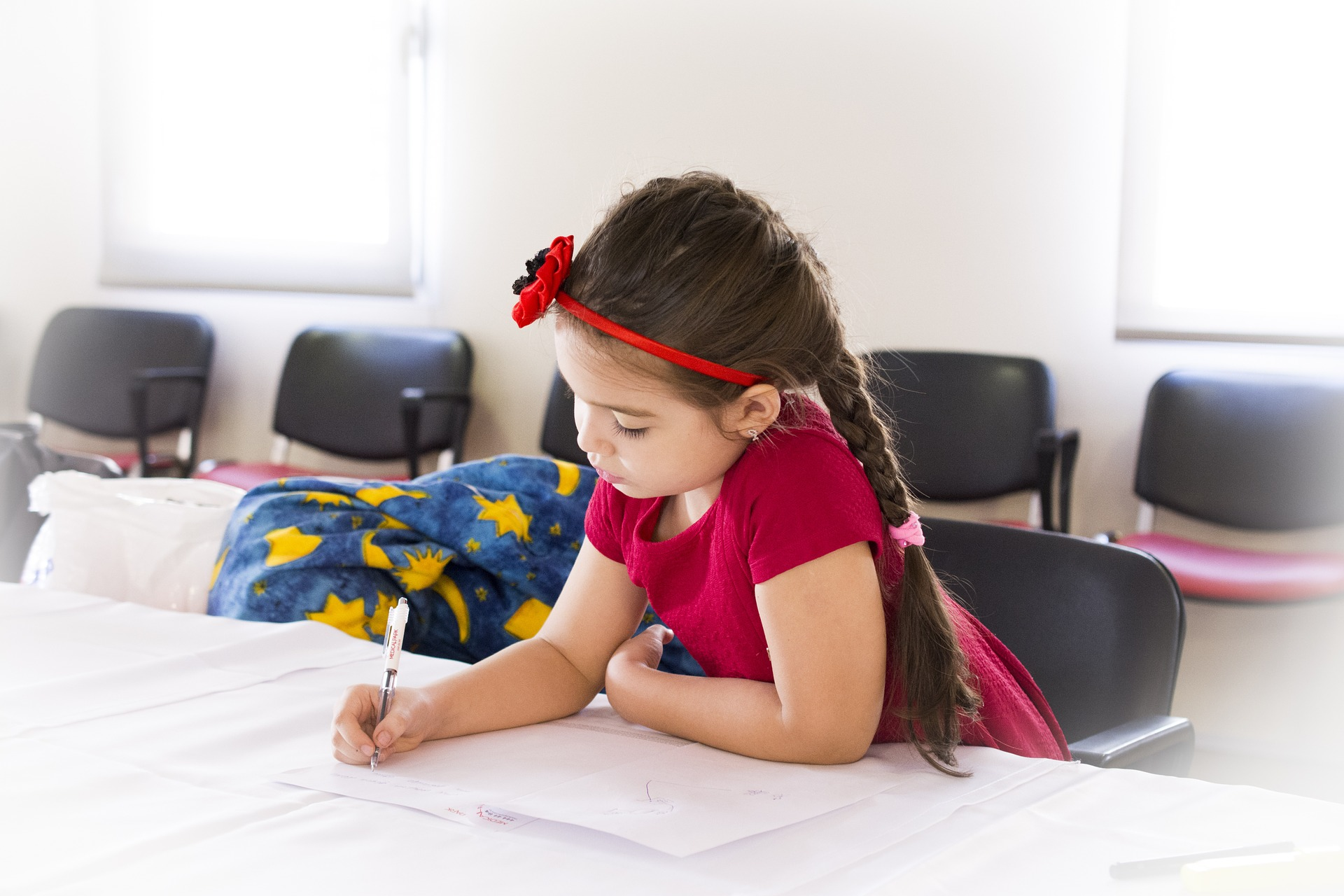 GIRL IS WRITING HOMEWORK