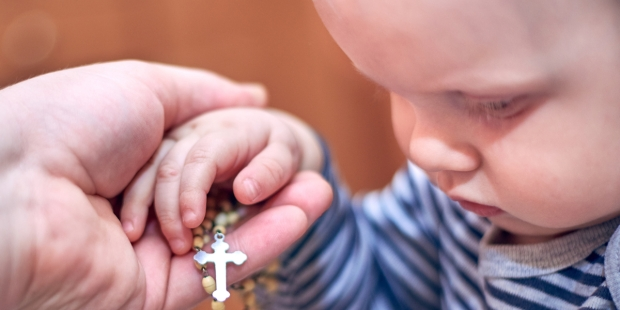 HANDS, ROSARY, CHILD