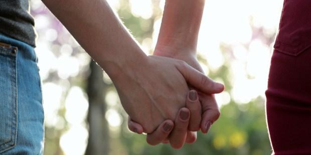 hands together sunlight
