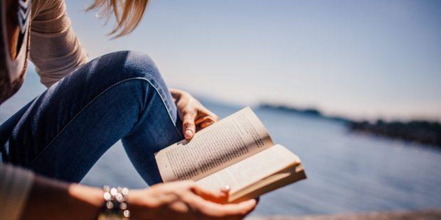 WOMAN, READING, SEA
