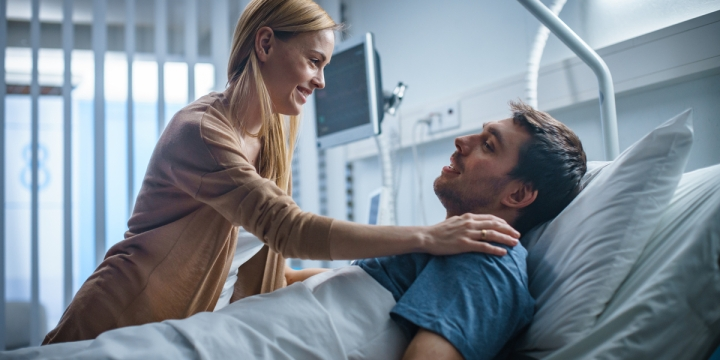 wife visits her husband in the hospital