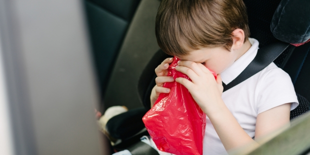 child vomiting in car