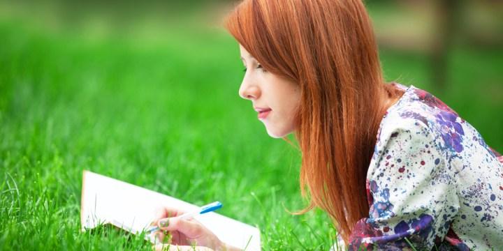 redhead girl writing