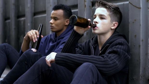teenager guys drinking beer