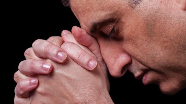 MATURE MAN PRAYING,