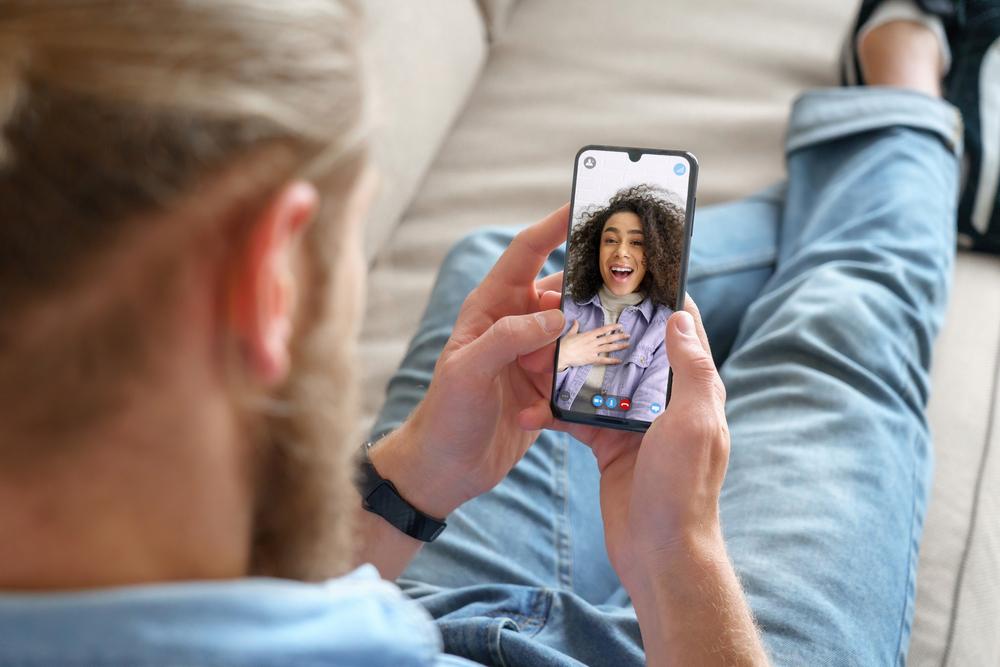 Young man; girlfriend; video call