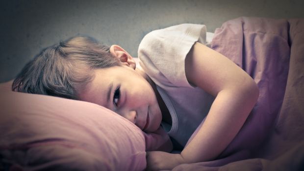 LITTLE BOY SLEEPING IN HIS BED,