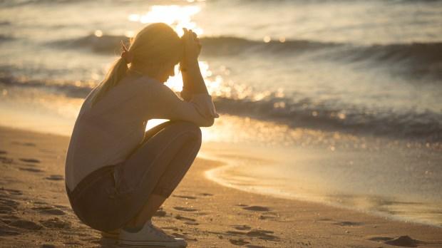 SAD WOMAN, BEACH